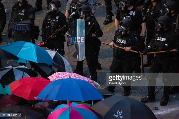 Demonstrators face off with law enforcement personnel near the Seattle Police Departments East Precinct on June 6, 2020 in Seattle, Washington. This...