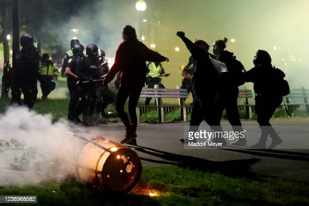 Demonstrators face off with police during a protest in response to the recent death of George Floyd on May 31, 2020 in Boston, Massachusetts....