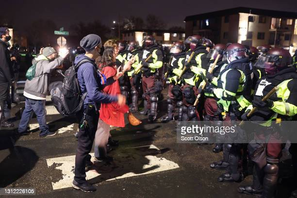 Demonstrators face off with police officers outside of the Brooklyn Center police station on April 12, 2021 in Brooklyn Center, Minnesota. People...