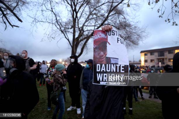 Demonstrators face off with police outside of the Brooklyn Center police station on April 12, 2021 in Brooklyn Center, Minnesota. People have taken...