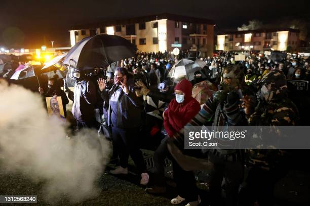 Demonstrators face off with sheriff deputies during a protest at the Brooklyn Center police station on April 14, 2021 in Brooklyn Center, Minnesota....