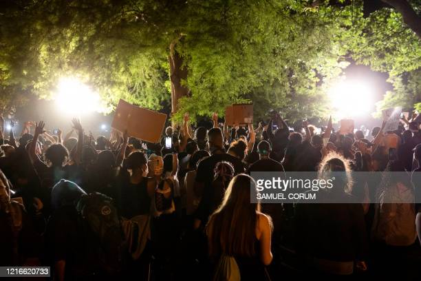 Demonstrators face off with the police in front of the White House as they protest against the death of George Floyd at the hands of Minneapolis...