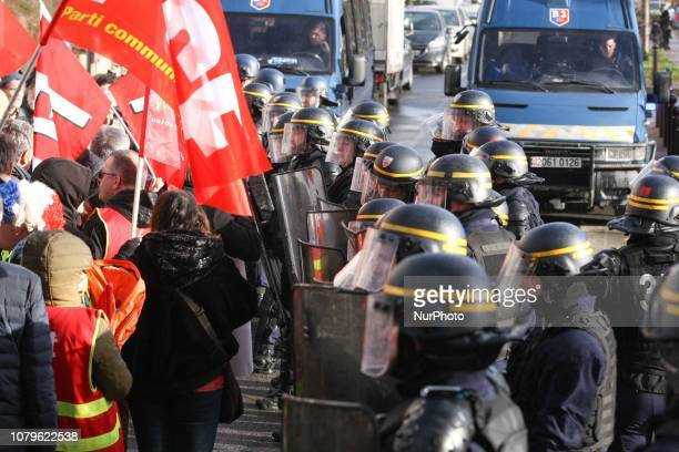 Demonstrators face riot police officers during a demonstration called by several trade unions to disrup the inauguration by the French President...