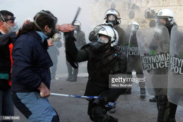 Demonstrators fight with riot police during violent protests on February 12 2012 in Athens Greece Thousands of demonstrators clashed with police as...