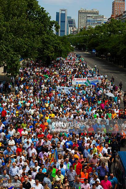 Demonstrators fill a city highway as they protest against the Uber Technologies Inc taxi app in central Madrid Spain on Wednesday June 11 2014 Uber...