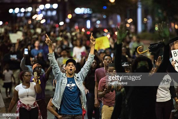 Demonstrators fill a downtown city street during protests September 21 2016 in Charlotte NC The protests began the previous night following the fatal...