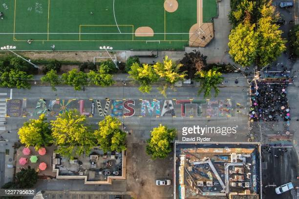 Demonstrators fill an intersection near a Black Lives Matter street mural during protests on July 26, 2020 in Seattle, Washington. Peaceful protests...