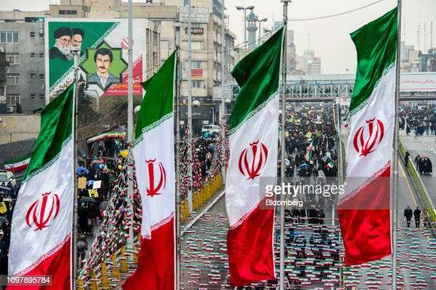 Demonstrators fill the street as Iranian national flag banners fly during the 40th anniversary of the Islamic revolution in Tehran Iran on Monday Feb...
