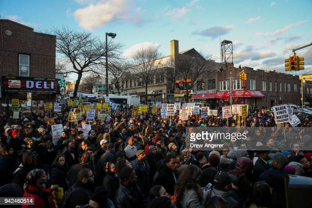 Demonstrators flood the intersection of Utica Avenue and Montgomery Street for a rally in protest of the policeinvolved shooting death of Saheed...