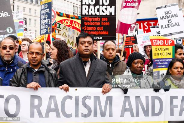 Demonstrators form up behind a banner on Portland Place ahead of an antiracism march through central London held to mark the 2015 International Day...