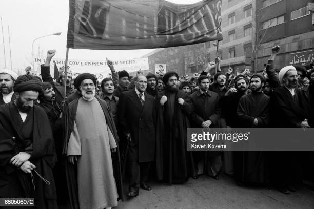 Demonstrators from all walks of life gather around clergymen on Ashura Day in Tehran during the Iranian Revolution 11th December 1978 As many as 17...