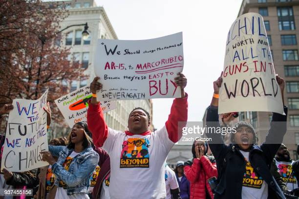 Demonstrators from Baltimore march in the March for Our Lives rally March 24, 2018 in Washington, DC. Hundreds of thousands of demonstrators,...