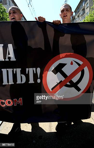 Demonstrators from Bulgarian ultra nationalists organizations shout anticommunist slogans during a march marking May Day on May 1 2010 in central...