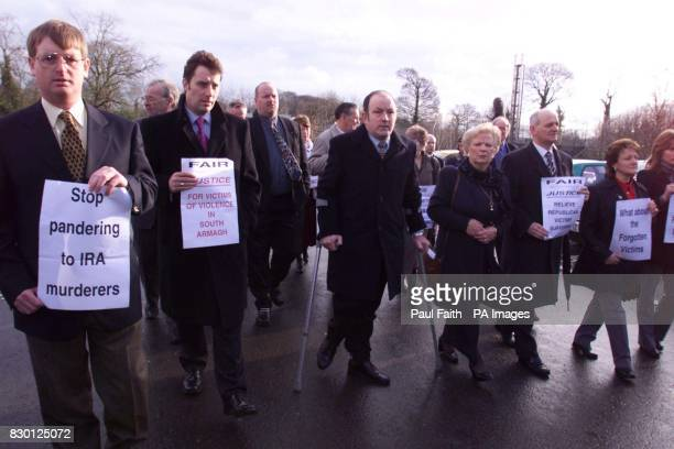 Demonstrators from Families Acting For Innocent Relatives arrive at Castle Buildings Belfast to protest at a meeting between Adam Ingram minister for...