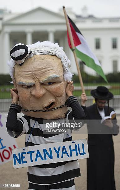 Demonstrators from Jews United Against Zionism and Code Pink protest Israeli Prime Minister Benjamin Netanyahu's visit to the White House in...