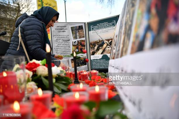 Demonstrators from the AngloIranian Communities in the UK attend a vigil opposite the gates of 10 Downing Street in central London on January 10 for...