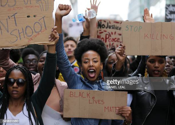 TOPSHOT Demonstrators from the Black Lives Matter movement march through central London on July 10 during a demonstration against the killing of...