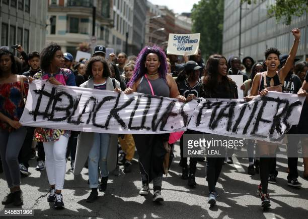 Demonstrators from the Black Lives Matter movement march through the streets of central London on July 10 during a demonstration against the killing...