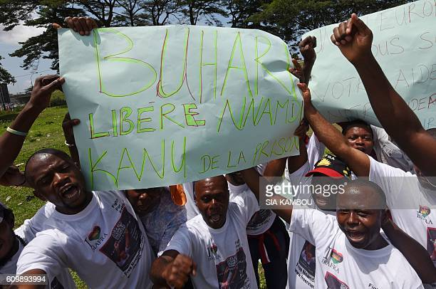Demonstrators from the Indigenous People of Biafra hold a sign reading 'Buhari free Nnamdi Kanu from prison' during a protest calling for the release...