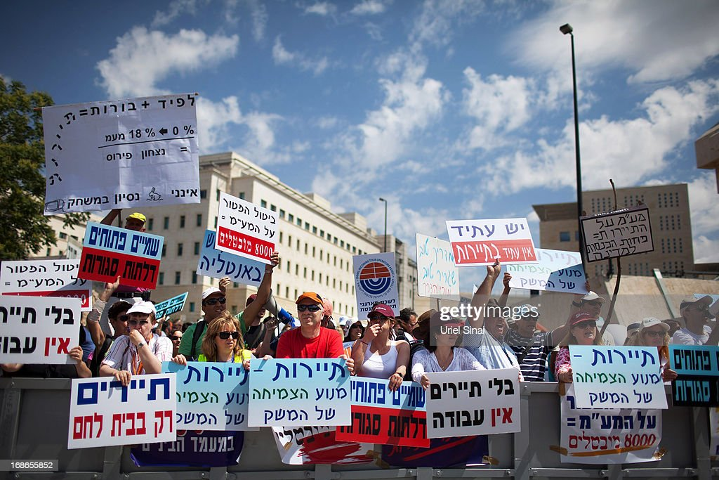 Demonstrators from the Israeli tourism industry protest against Israeli Finance Minister Yair Lapid's budget cuts outside the prime minister's office during the Israeli cabinet meeting on May 13, 2013 in Jerusalem, Israel. Thousands of Israelis took to the streets over the weekend to protest against austerity measures presented as part of the state's new budget. The Prime Minister Benjamin Netanyahu announced a proposed reduction in cuts to the defence budget at a cabinet meeting today.