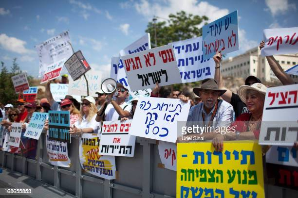 Demonstrators from the Israeli tourism industry protest against Israeli Finance Minister Yair Lapid's budget cuts outside the prime minister's office...