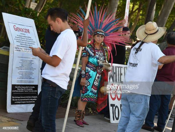 Demonstrators from the Native American Mexica Movement march to a statue of Christopher Columbus during a protest against Columbus Day in Grand Park...