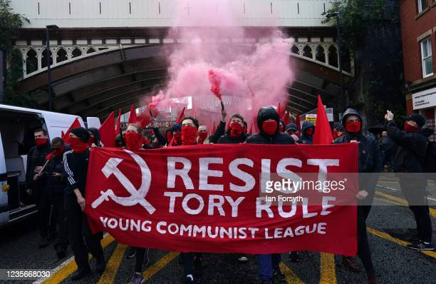 Demonstrators from the People's Assembly take part in a march to protest against the Conservative Party Conference on October 3, 2021 in Manchester,...