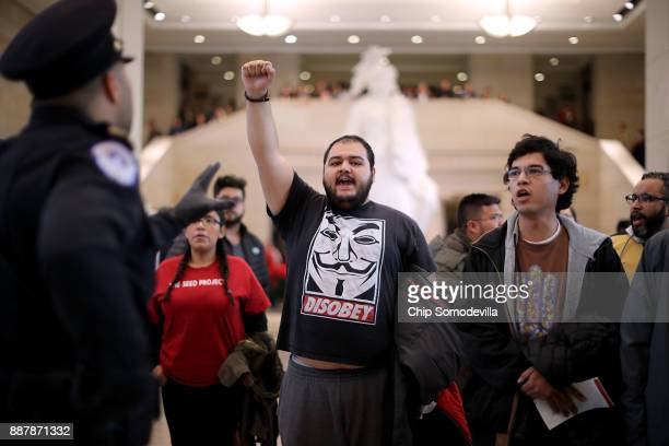 Demonstrators from The Seed Project stage a protest in the US Capitol Visitors Center to demand immigration reform and a renewal of the Deferred...