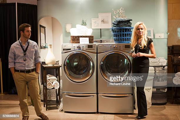 Demonstrators from Whirlpool promote their laundry machines at an Earth Fair in Grand Central Terminal in New York on Thursday, April 21, 2011....