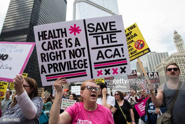 Demonstrators gather across from Trump International Hotel and Tower in Chicago to celebrate the Republican Partys failed repeal of the Affordable...