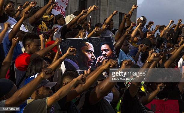 Demonstrators gather after marching at the Louisiana Capitol to protest the shooting of Alton Sterling on July 9 2016 in Baton Rouge Louisiana Alton...
