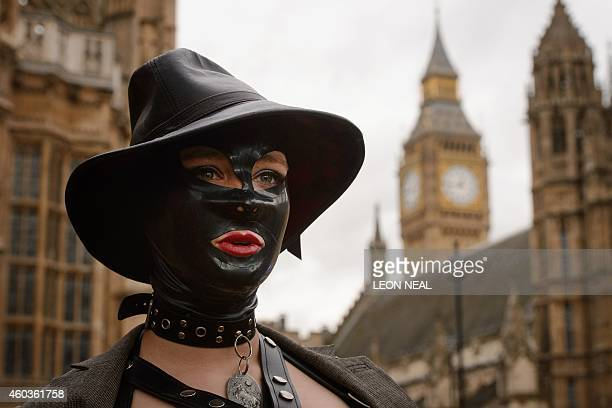 Demonstrators gather ahead of a mass 'facesitting protest' outside the Houses of Parliament in central London on December 12 as they protest against...