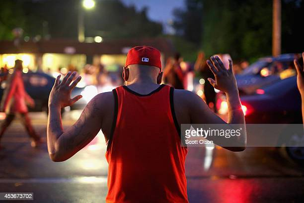Demonstrators gather along West Florissant Avenue to protest the shooting of Michael Brown on August 15, 2014 in Ferguson, Missouri. Brown was shot...