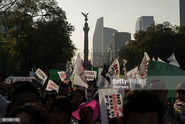 Demonstrators gather and hold signs during a protest against the gasoline price hike in Mexico City Mexico on Monday Jan 9 2017 The government is...