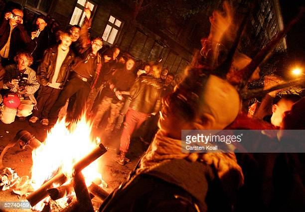 Demonstrators gather around a fire in the district of Friedrichshain April 30 2005 in Berlin Germany Walpurgis Night or Walpurgisnacht falls on the...