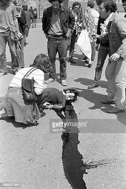 Demonstrators gather around the body of student Jeffrey Miller who was shot and killed by guardsmen during an antiwar demonstration at Kent State...