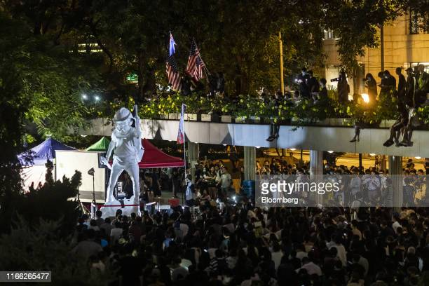 Demonstrators gather around the Lady Liberty Hong Kong statue during a rally organized by the Social and Political Organizations Workers Union at...