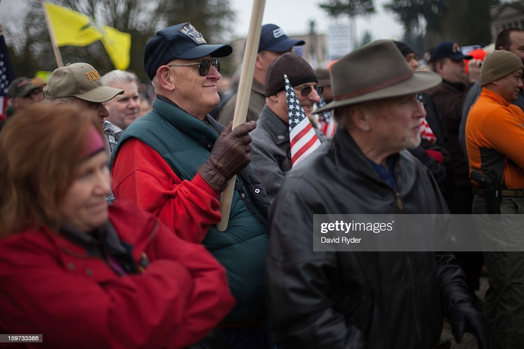 Demonstrators gather at a pro-gun rally on January 19, 2013 in Olympia, Washington. The Guns Across America national campaign drew thousands of protesters to state capitols, including over 1,000 in Olympia.