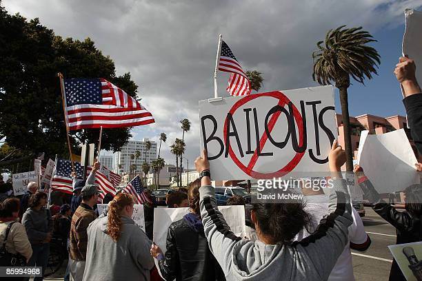 Demonstrators gather at an American Family Association sponsored TEA Party to protest taxes and economic stimulus spending on the last day to file...