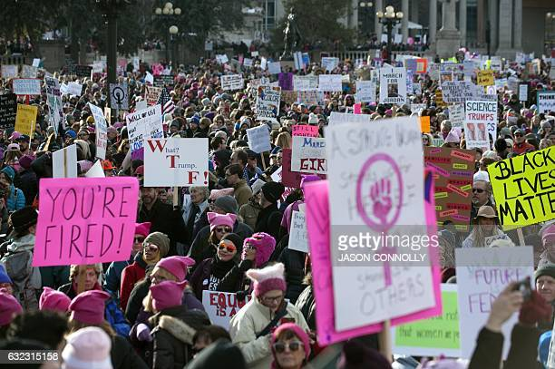 Demonstrators gather at Civic Center Park in Denver Colorado during the Women's March on January 21 2017 Hundreds of thousands of people packed the...