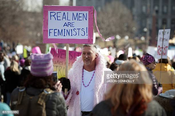 TOPSHOT Demonstrators gather at Civic Center Park in Denver Colorado during the Women's March on January 21 2017 Hundreds of thousands of people...