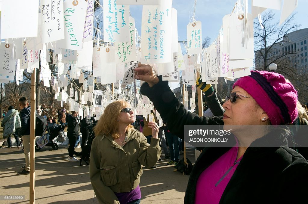 Demonstrators gather at Civic Center Park in Denver, Colorado, during the Women's March on January 21, 2017. Hundreds of thousands of people packed the streets across the US on Saturday in a massive outpouring of defiant opposition to America's new president, Donald Trump. / AFP / Jason Connolly
