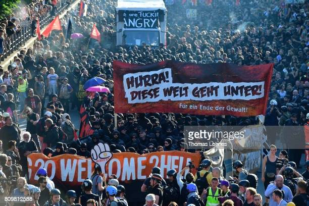Demonstrators gather at Hamburg harbor prior to the 'Welcome to Hell' antiG20 protest march on July 6 2017 in Hamburg Germany Leaders of the G20...