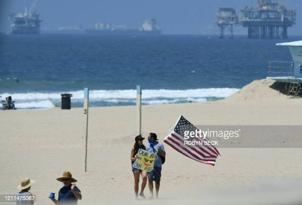 Demonstrators gather at Huntington beach to protest the state's stayathome order amid the coronavirus pandemic on May 1 2020 in California