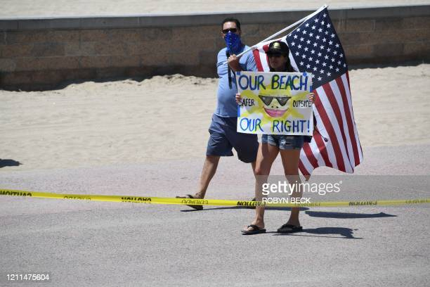 Demonstrators gather at Huntington beach to protest the state's stayathome order amid the coronavirus pandemic on May 1 2020 in California Beaches in...