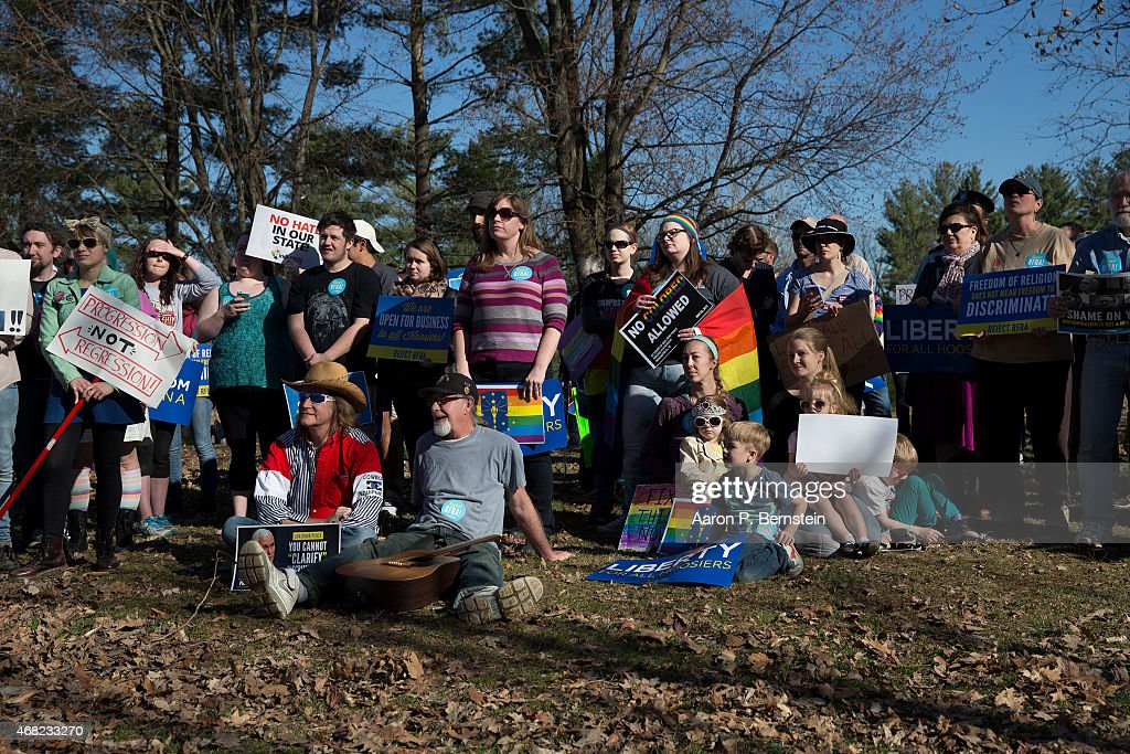 Demonstrators gather at Karst Farm Park on March 31, 2015 in Bloomington, Indiana. Responding to widespread criticism nationally over the state's new controversial Religious Freedom Restoration Act, which critics say can be used to discriminate against gays and lesbians, Indiana Gov. Mike Pence today called on the Republican-controlled general assembly to 'fix' the law, making clear that businesses cannont use the law to deny services to same-sex couples, according published reports.