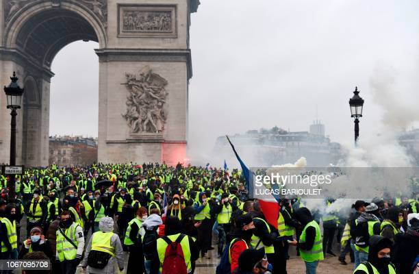 Demonstrators gather at the Arc of Triomphe on the Champs Elysees avenue in Paris during a protest of Yellow vests against rising oil prices and...