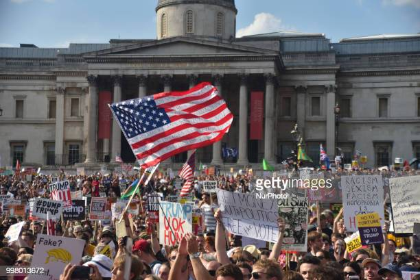 Demonstrators gather at Trafalgar Square as they attend a rally against the US President Donald Trumps visit to the UK including a giant inflatable...