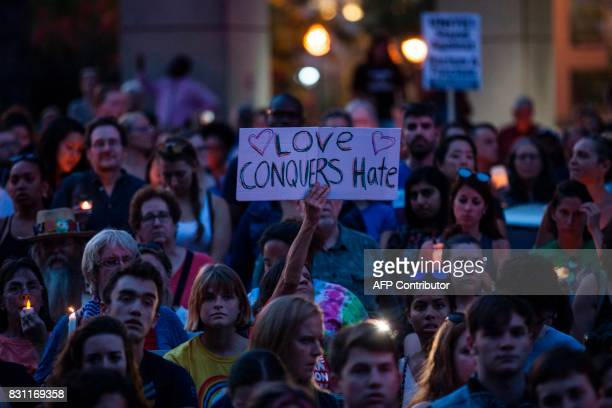 Demonstrators gather August 13 2017 before a statue of Confederate General Albert Pike the only member of the Confederate military with an outdoor...