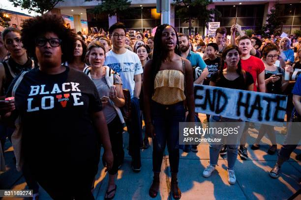 Demonstrators gather August 13 2017 in front of a statue of Confederate General Albert Pike the only member of the Confederate military with an...